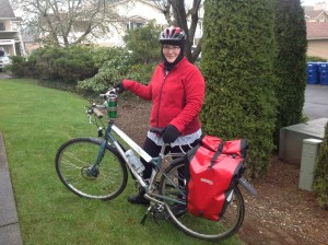 Novarra women's bike, 8-speed, with red Ortlieb panniers.