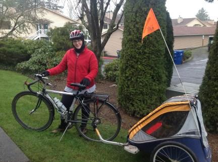 Michelle with Sekai women's bike and bike trailer to haul kids.