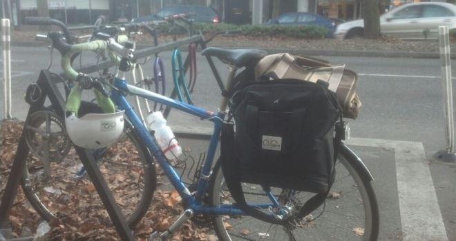 Bike parked in bike rack made of bike parts at Kaffee Klatsch, Lake City Way, Seattle, WA