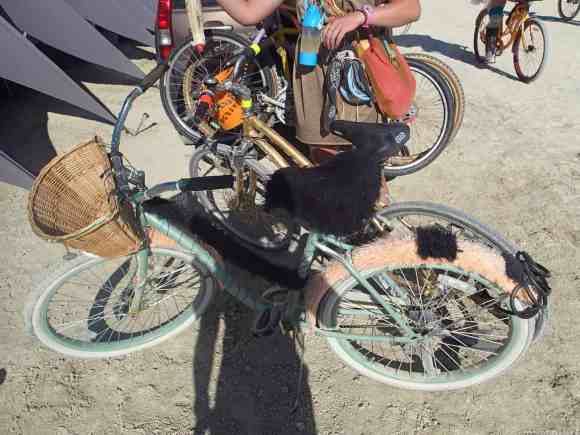 Two bikes locked together with a cable lock at burning man