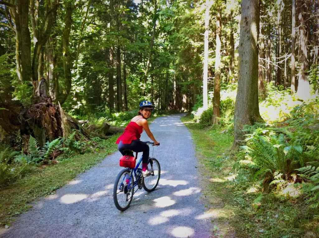 Riding on a walking and bicycling trail through the forest on Vancouver Island