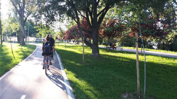 Commuting on a beautiful car-free path through greenery.