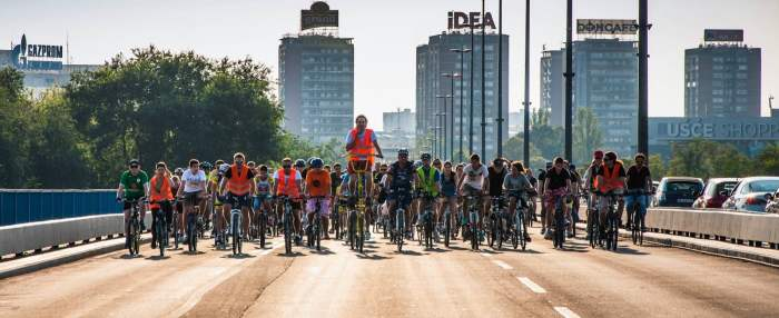 Critical mass taking over a bridge in Belgrade. Lead by someone on a tall bike.