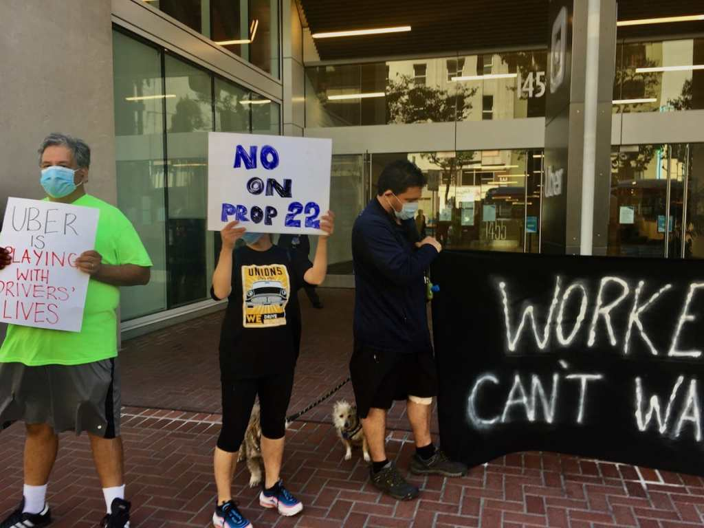 protester fighting for no on prop 22 at uber hq