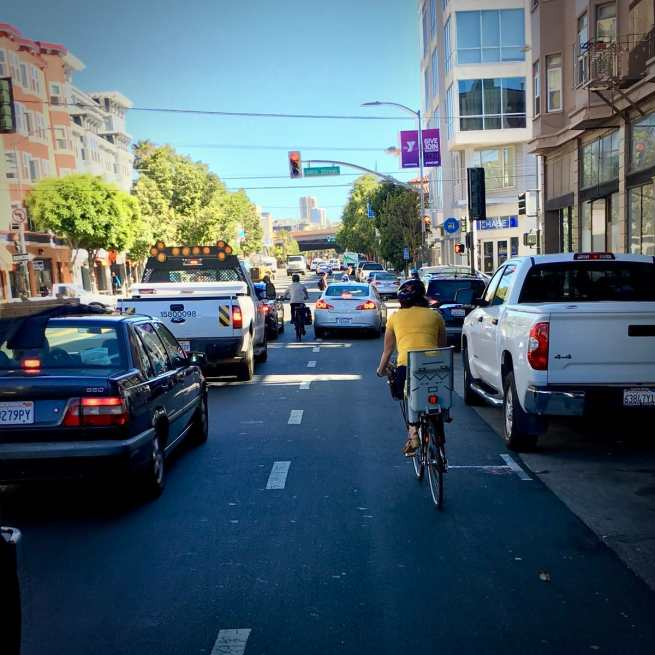 cars and bikes sharing the road and avoiding the right hook on valencia street