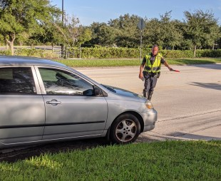 An Orlando Police officer pulls over a driver who failed to yield to a pedestrian in the crosswalk at Metrowest Blvd & MetroCenter Blvd.