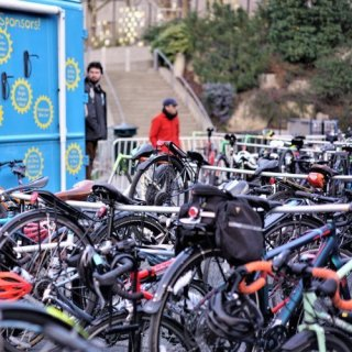 Rows of bikes on portable bike stands displaying our bike valet service