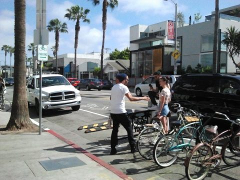 Just out of the frame, one more bike and two more guys sitting on the railing having lunch.