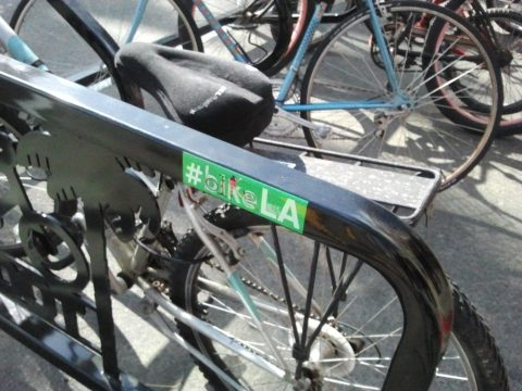 One of the new bike corrals adorned with the new LADOT #bikeLA sticker.