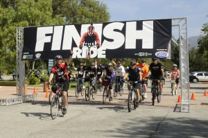 Over a year later, Damian Kevitt finishes the ride; photo courtesy of Finish the Ride.