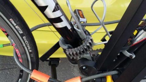 Bike chained to car rack