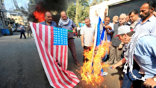 United States and Israel as enemies: Palestinians demonstrate in Ain al-Hilweh refugee camp in southern Lebanon against Bahrain investor conference. (Source: Reuters / Ali Hashisho)