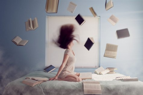 Woman surrounded by flying books.