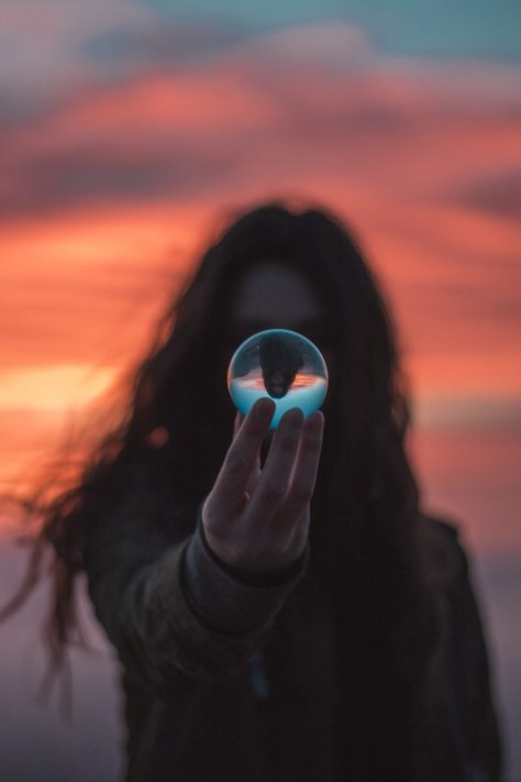 Woman looking at a glass sphere