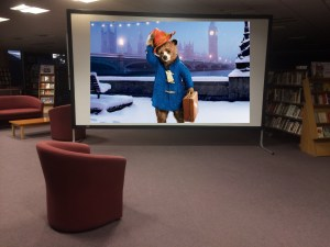 It's big !!! Our screen measures about 2.5 metres by 3.6 metres. This was the very first time it was set up in the Library (the image of Paddington is Photoshopped onto it !)