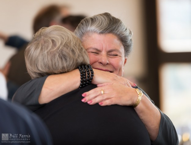 A celebratory embrace during the National Philanthropy Day event at Prescott Resort