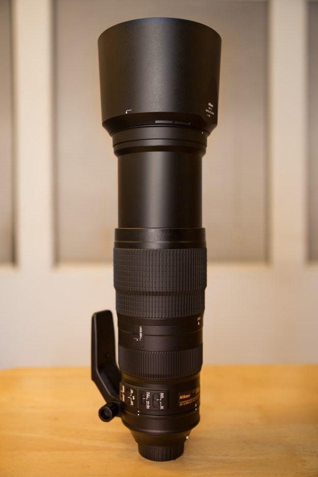 The Nikon AF-S 200-500mm f/5.6E ED VR zoom lens fully extened to 500mm with the lens hood attached.