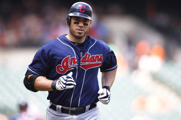 """""""Cleveland Indians designated hitter Travis Hafner runs toward home plate after hitting a solo home run in the first inning of a baseball game against the Baltimore Orioles Sunday, July 17, 2011 in Baltimore."""""""