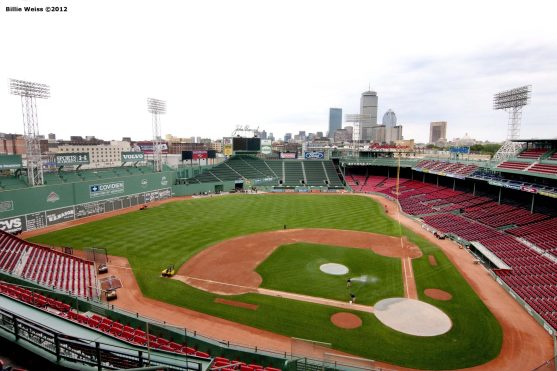 """""""Members of the grounds crew prepare the field at Fenway Park in Boston, Massachusetts Sunday, August 15, 2010 after a performance by Aerosmith and the J. Geils Band the previous evening."""""""