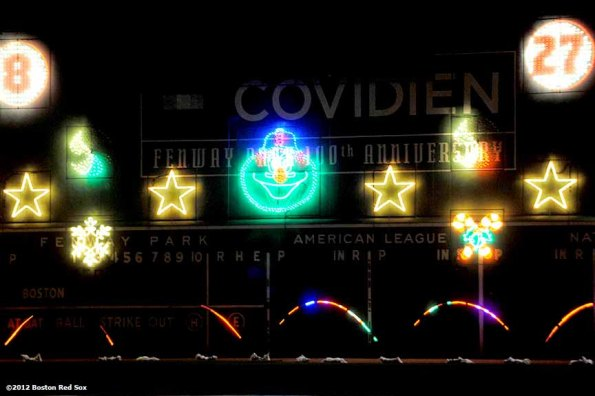 """""""An LED Winter Lights musical show is projected on the Green Monster during Fenway Park Holiday Bash Friday, November 30, 2012. The event featured player and alumni meet and greets, a Fenway Winter Village set up in the Big Concourse, and access for fans to the home clubhouse and warning track. """""""