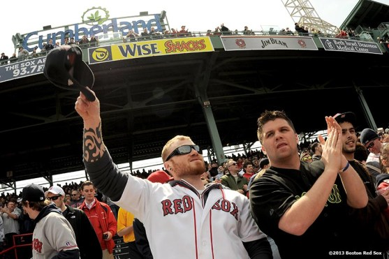 """""""Fans cheer during a game between the Boston Red Sox and the Tampa Bay Rays Monday, April 15, 2013 at Fenway Park in Boston, Massachusetts."""""""