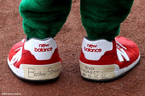 """""""Wally the Green Monster mascot shows his Boston Strong shoes during the first Boston Red Sox home game after the attacks on the 2013 Boston Marathon Saturday, April 20, 2013."""""""