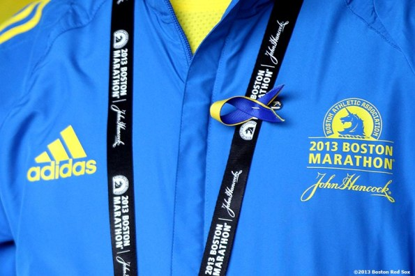 """""""Marathon Volunteers are introduced during a pre-game ceremony honoring the victims, first responders, and others involved in the attacks on the 2013 Boston Marathon Saturday, April 20, 2013."""""""
