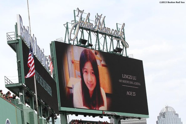 """""""A picture of Lingzi Lu, one of the victims of the Boston Marathon attacks, is shown on the scoreboard during a pre-game ceremony honoring the victims, first responders, and others involved in the attacks on the 2013 Boston Marathon Saturday, April 20, 2013."""""""