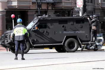 Boston SWAT team members patrol near the perimeter of Copley Square after two explosions were detonated at the finish line of the 2013 Boston Marathon. (Billie Weiss)