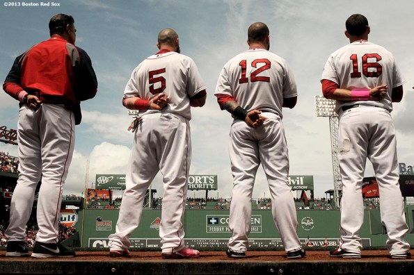 """""""Boston Red Sox manager John Farrell, outfielder Jonny Gomes, first baseman Mike Napoli, and third baseman Will Middlebrooks, line up in front of the dugout during the National Anthem before a game against the Toronto Blue Jays Sunday, May 12, 2013 at Fenway Park in Boston, Massachusetts."""""""