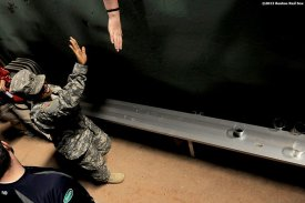 """""""Sgt. First Class Michelle Lowes of the New Hampshire Army National Guard high fives a fan after singing 'God Bless America' during a game between the Boston Red Sox and the Philadelphia Phillies Monday, May 27, 2013 at Fenway Park in Boston, Massachusetts."""""""