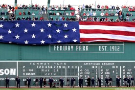 """""""An American flag is dropped over the Green Monster at Fenway Park in honor of Memorial Day Monday, May 27, 2013 at Fenway Park in Boston, Massachusetts."""""""