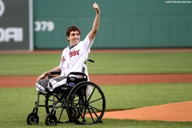 """""""Jeff Bauman, who lost both of his legs during the Boston Marathon bombings, waves to the crowd before throwing out the ceremonial first pitch before a game between the Boston Red Sox and the Philadelphia Phillies at Fenway Park in Boston, Massachusetts Tuesday, May 28, 2013."""""""