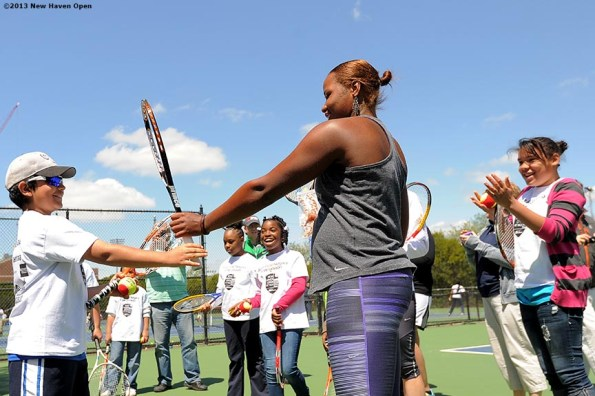"""""""Professional Tennis Player Taylor Townsend leads a tennis drill Monday, May 13, 2013 at a free tennis lesson promotional event leading up to the New Haven Open Tennis Tournament at Yale University in New Haven, Connecticut. Over three hundred children from ten New Haven public schools attended the event."""""""