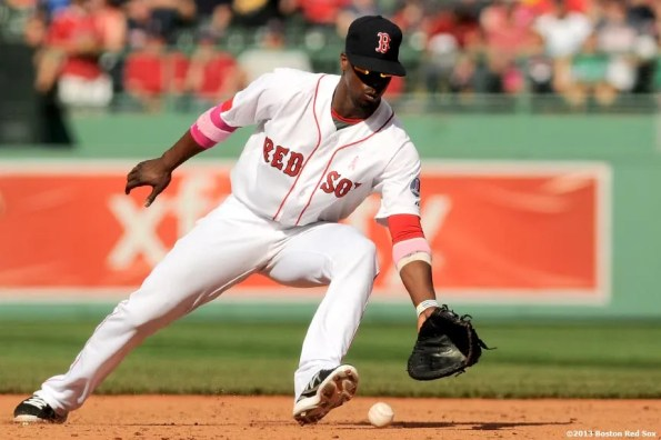 """""""Boston Red Sox infielder Pedro Ciriaco fields a ground ball at first base during the ninth inning of a game against the Toronto Blue Jays Sunday, May 12, 2013 at Fenway Park in Boston, Massachusetts."""""""