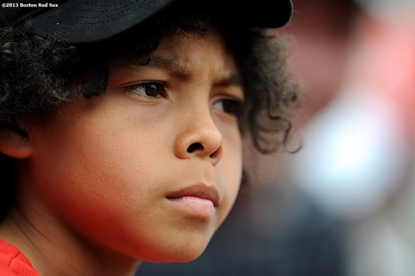 """""""A young fan watches a game between the Boston Red Sox and the Los Angeles Angels of Anaheim Saturday, June 8, 2013 at Fenway Park in Boston, Massachusetts."""""""