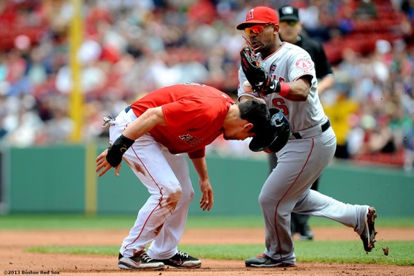 """""""Boston Red Sox centerfielder Jacoby Ellsbury is tagged out in a rundown by third baseman Alberto Callaspo during the first inning of a game against the Los Angeles Angels of Anaheim Saturday, June 8, 2013 at Fenway Park in Boston, Massachusetts."""""""