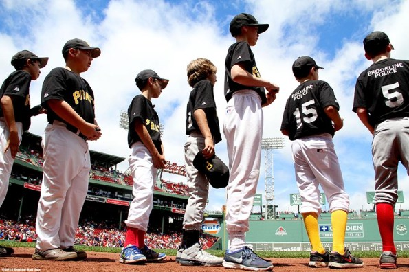 """""""Brookline little league players prepare to take the field for a pre-game ceremony before a game between the Boston Red Sox and the Los Angeles Angels of Anaheim Saturday, June 8, 2013 at Fenway Park in Boston, Massachusetts."""""""