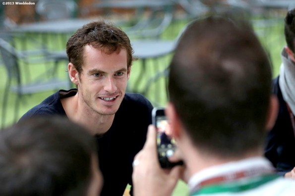 """""""Andy Murray answers questions for a social media promotion on the players lawn at the All England Lawn and Tennis Club in London, England Friday, June 27, 2013 during the 2013 Championships Wimbledon."""""""