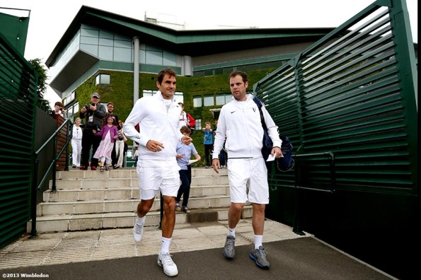 """""""Roger Federer walks toward the outer courts before a practice session at the All England Lawn and Tennis Club in London, England Saturday, June 22, 2013 before the start of the 2013 Championships Wimbledon."""""""