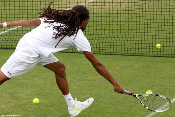 """""""Dustin Brown reaches for a volley during a practice session at the All England Lawn and Tennis Club in London, England Thursday, June 27, 2013 during the 2013 Championships Wimbledon."""""""