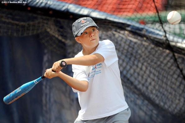 """""""A Boston Red Sox CVS Hitting Clinic participant takes batting practice on the field at Fenway Park in Boston, Massachusetts Monday, July 22, 2013."""""""