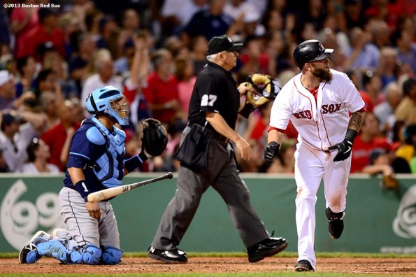 """""""Boston Red Sox first baseman Mike Napoli hits a solo home run during the seventh inning of a game against the Tampa Bay Rays Thursday, July 24, 2013 at Fenway Park in Boston, Massachusetts."""""""