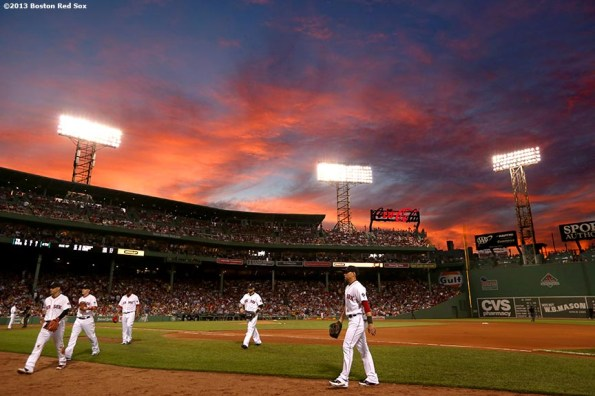 """""""The sun sets over Fenway Park during a game between the Boston Red Sox and the Tampa Bay Rays Thursday, July 24, 2013."""""""