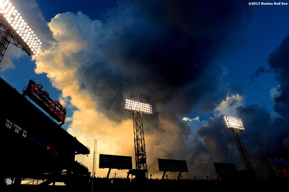 """""""Clouds form over the Green Monster at Fenway Park in Boston, Massachusetts during a game between the Boston Red Sox and the Tampa Bay Rays Monday, July 29, 2013."""""""