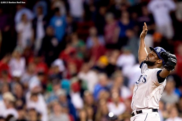 """""""Tampa Bay Rays closer Fernando Rodney reacts after recording a save during the ninth inning of a game against the Boston Red Sox Monday, July 29, 2013 at Fenway Park in Boston, Massachusetts."""""""
