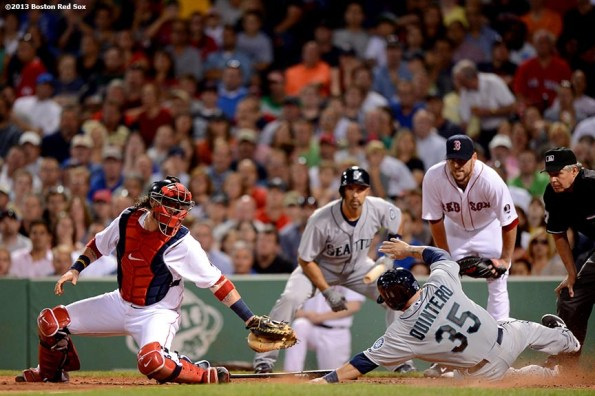 """""""Boston Red Sox catcher Jarrod Saltalamacchia attempts to tag out catcher Humberto Quintero at home plate during the sixth inning of a game against the the Seattle Mariners Wednesday, July 31, 2013 at Fenway Park in Boston, Massachusetts."""""""