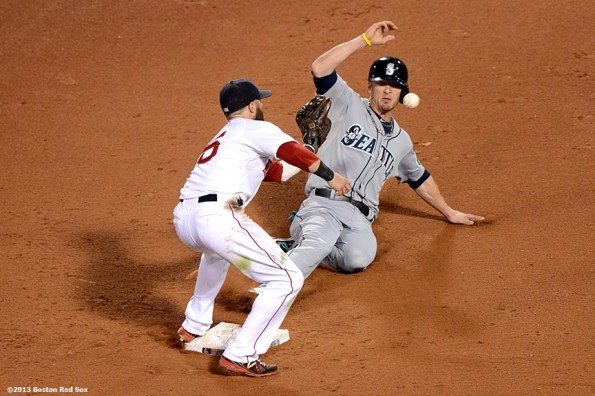"""""""Boston Red Sox second baseman Dustin Pedroia applies a tag on Brendan Ryan at second base during the twelfth inning of a game against the Seattle Mariners Wednesday, July 31, 2013 at Fenway Park in Boston, Massachusetts."""""""