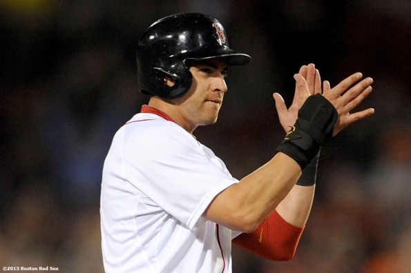 """""""Boston Red Sox center fielder Jacoby Ellsbury claps after stealing second base during the eighth inning of a game against the Baltimore Orioles Thursday, August 29, 2013 at Fenway Park in Boston, Massachusetts."""""""