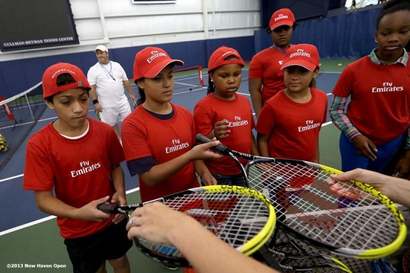 """""""Kids are given racquets during an Emirates Airline tennis clinic on Day 7 of the New Haven Open at Yale University in New Haven, Connecticut Thursday, August 20, 2013."""""""